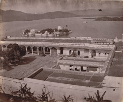 View across courtyards in the City Palace looking towards the Pichola Lake, with the Jag Niwas (Lake Palace) in the foreground, Udaipur
